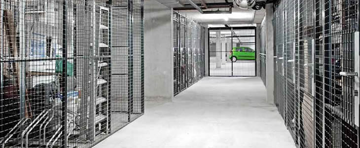 Wire mesh partitions form independent areas with service windows.
