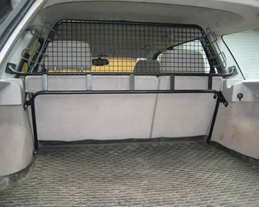 A half piece of wire mesh partition for transit connect is installed on the top part of the front seats.