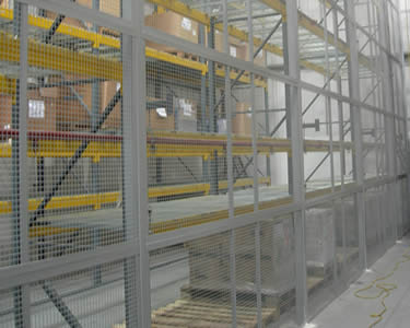 A heavy duty wire mesh partition wall for heavy industry with great height and grey powder coated surface.